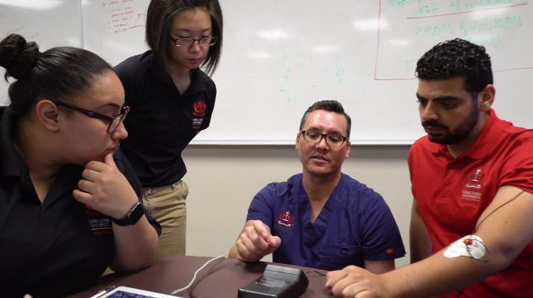 Physical Therapy students conduct research with professor
