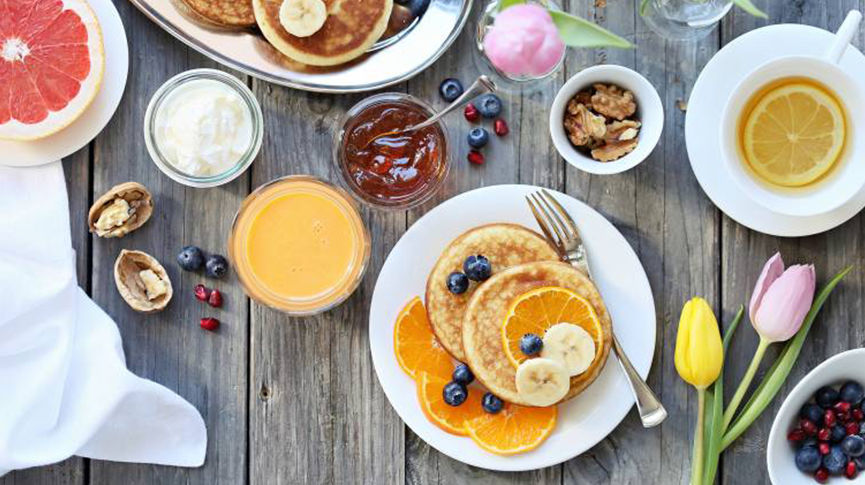 table full of various breakfast foods